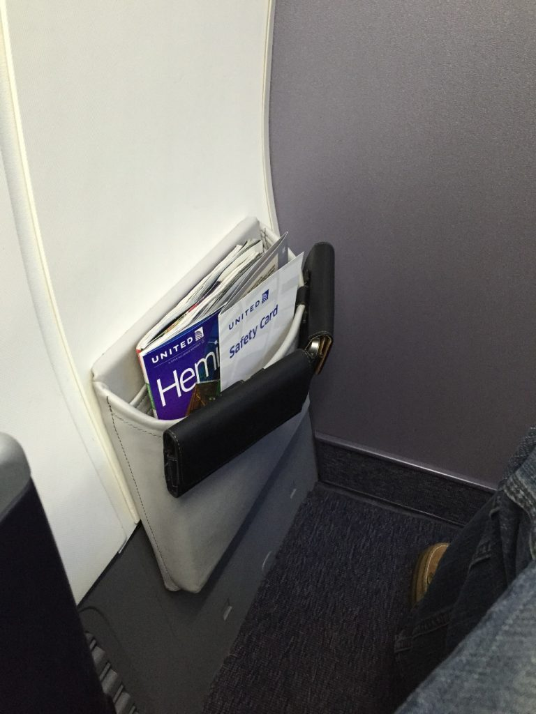 United Airlines Aircraft Fleet Boeing 737-900ER Business:First Class Seatback pocket photos