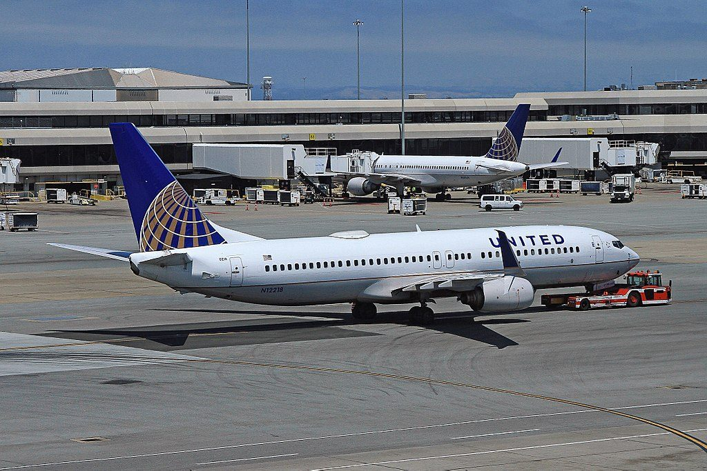 United Airlines Aircraft Fleet N12218 Boeing 737-824 with airport tug at SFO San Francisco International Airport