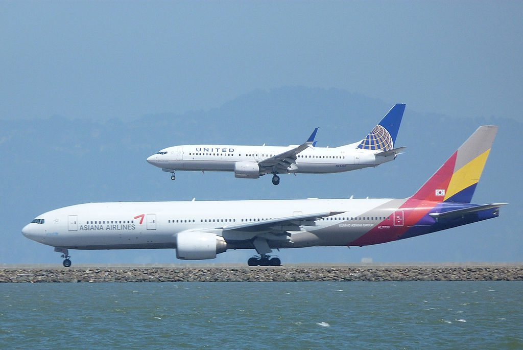 United Airlines, Boeing 737-824(WL), N77518 - Asiana Airlines, Boeing 777-28E(ER) at SFO
