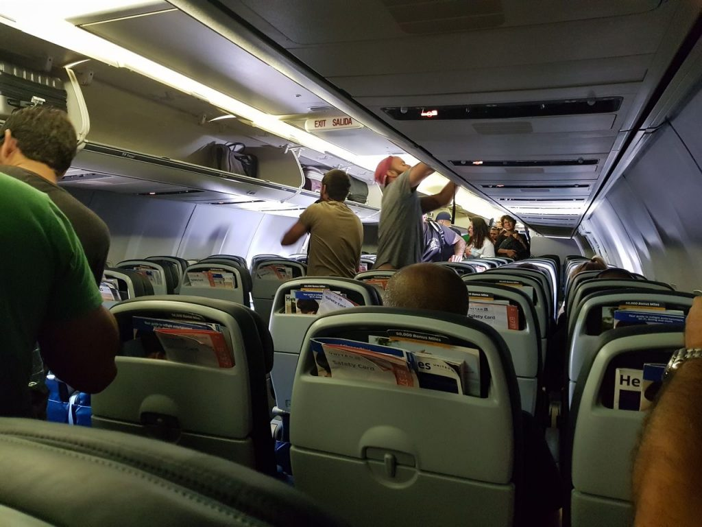 United Airlines Fleet Boeing 737-800 Main Cabin Economy Class Passenger Boarding With Baggage on Overhead Panels and Bins