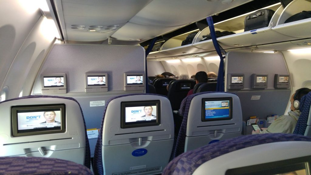 United Airlines Fleet Boeing 737-800 Premium Eco:Economy Fresh Cabin Bulkhead Seats and DirectTV Panel Photos