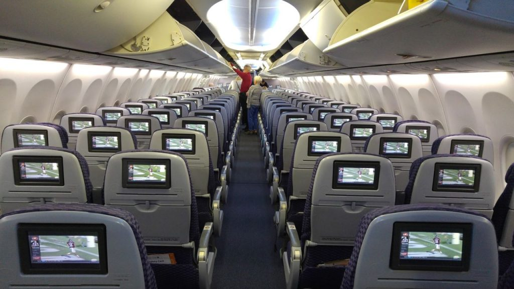 United Airlines Fleet Boeing 737-800 Premium Eco:Economy Fresh Cabin Interior With Overhead Panels Bins and 3-3 Seats Row Configuration