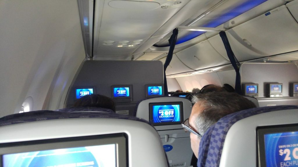 United Airlines Fleet Boeing 737-800 Premium Eco:Economy Plus Cabin view during takeoff