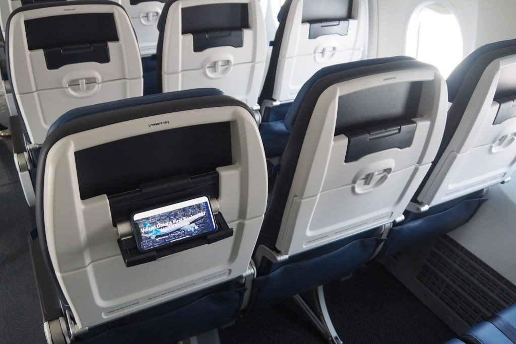 United-Airlines-Fleet-Boeing-737-Max-9-N67501-Aircraft-economy-seats-offer-a-pop-down-platform-at-the-back-of-each-seat.jpg