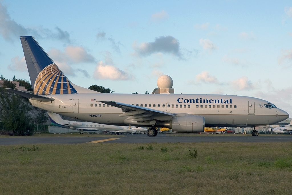 United Airlines Fleet N24715 (ex Continental Airlines) Boeing 737-724 cn:serial number- 28786:125 taxiing on runway at Philipsburg : St. Maarten - Princess Juliana (SXM : TNCM), St. Maarten