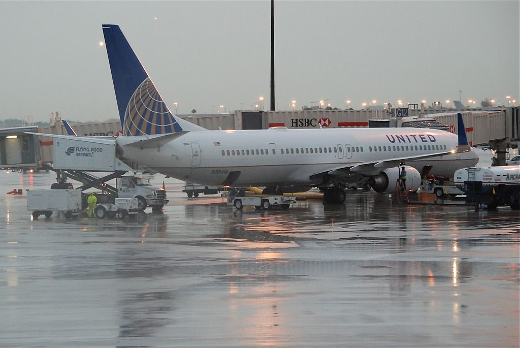 United Airlines Fleet Narrow Body Aircraft Boeing 737-900ER; N39416 on boarding gate at MIA Miami International Airport
