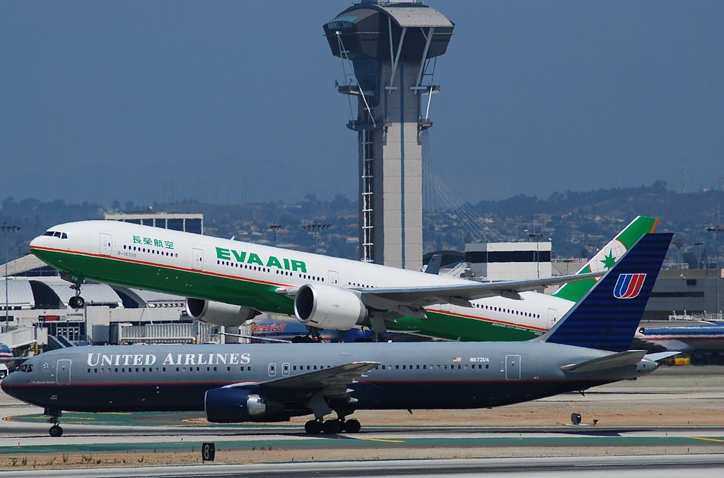 Boeing 767 322ER cnserial number 29241779 United Airlines N673UA by side EVA AIR 777 300ER B 16709 at LAX