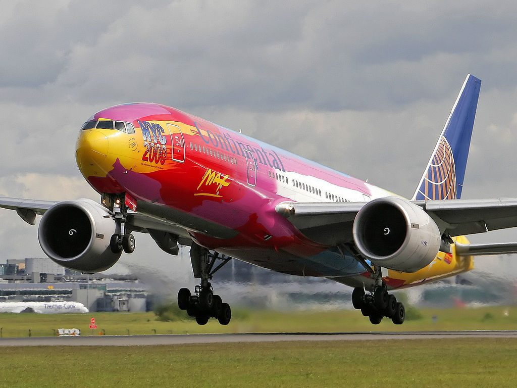 Continental Airlines United N77014 Boeing 777 200ER 22Peter Max22 livery colors taking off from Manchester Airport