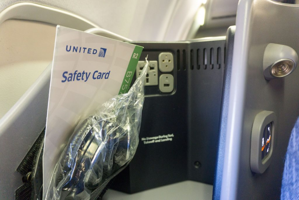 United Airlines Aircraft Fleet Boeing 757-200 Polaris Business:First Class Cabin seats small area at the upper corner of the seat where headphones, charging ports and an additional light were