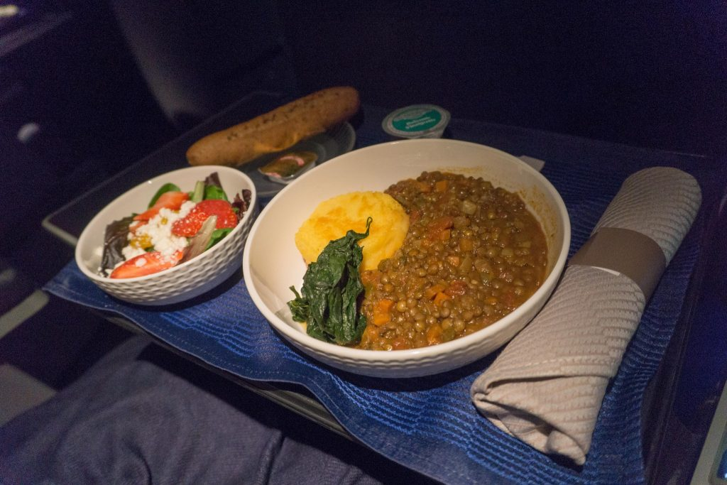 United Airlines Aircraft Fleet Boeing 757-200 Polaris Business:First Class Inflight Amenities Lentils with a small salad that had strawberries and feta meal:food services