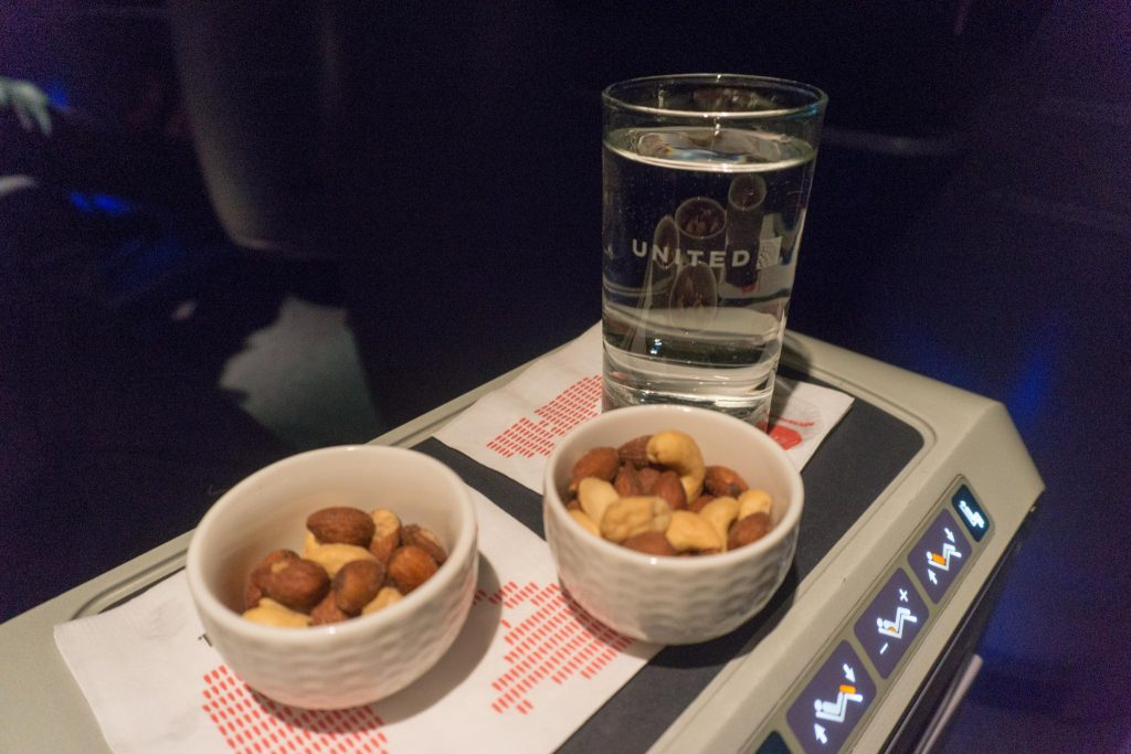 United Airlines Aircraft Fleet Boeing 757-200 Polaris Business:First Class Inflight Amenities Warm Towels, Mixed Nuts, and Drinks
