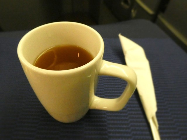 United Airlines Aircraft Fleet Boeing 777 200 Pre Merger Business Class Cabin Inflight Amenities cup of lemon tea after the meal