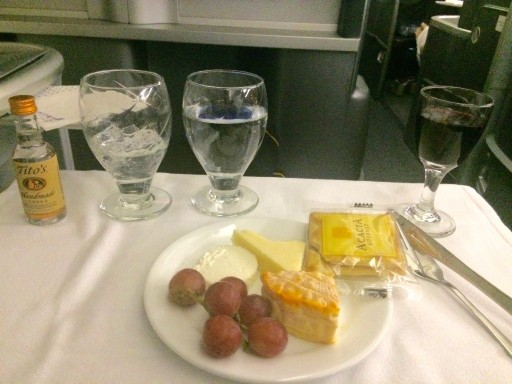 United Airlines Aircraft Fleet Boeing 777 200 Pre Merger BusinessFirst Class Cabin Meal Food services cheese course followed with a delightful Brie
