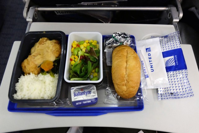 United Airlines Aircraft Fleet Boeing 777 200ER Economy Class Cabin inflight amenities meals bread and corn salad menu