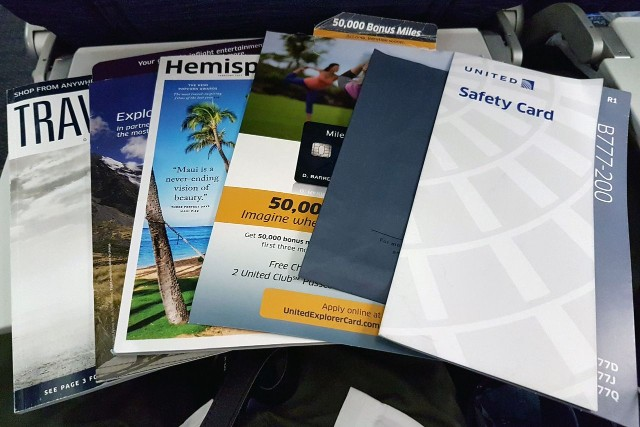 United Airlines Aircraft Fleet Boeing 777 200ER Economy Class Cabin seatback materials with a barf bag