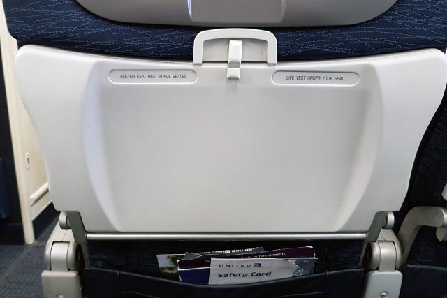 United Airlines Aircraft Fleet Boeing 777 200ER Economy Class Cabin seats tray table with a coat hook