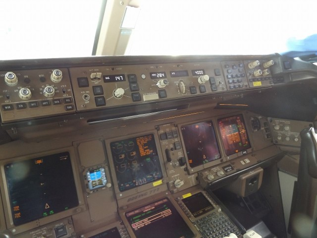 United Airlines Aircraft Fleet Boeing 777 200ER cockpit control panel captain seat view photos