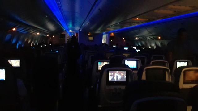 United Airlines Aircraft Fleet Boeing 777 300ER Economy Class Cabin Inflight Dark Mode Photos