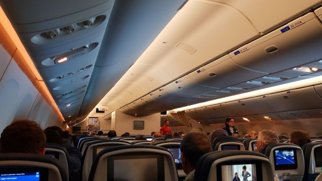 United Airlines Aircraft Fleet Boeing 777 300ER Economy Class Cabin Inflight lights on before landing