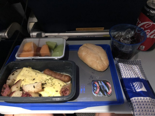 United Airlines Aircraft Fleet Boeing 777 300ER Economy Plus Premium Eco Cabin Inflight Amenities MealFood Breakfast Services omelet with garnish menu