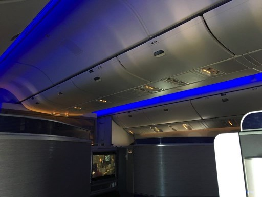 United Airlines Aircraft Fleet Boeing 777 300ER Polaris Business Class cabin mood lighting mid flight photos