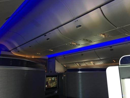 United Airlines Aircraft Fleet Boeing 777 300ER Polaris Business Class cabin mood lighting mid flight photos