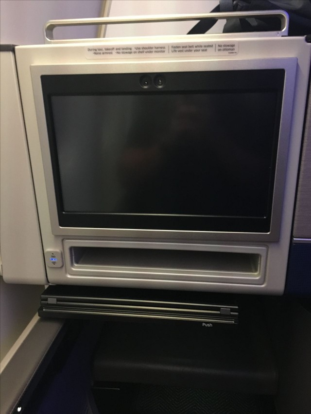 United Airlines Aircraft Fleet Boeing 777 300ER Polaris First Class Cabin IFE and the tray table slid out from under