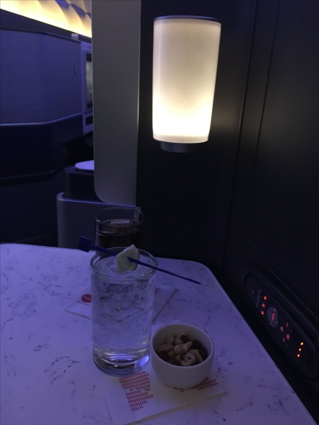 United Airlines Aircraft Fleet Boeing 777 300ER Polaris First Class Cabin Inflight Amenities Beverages Services with warm nuts