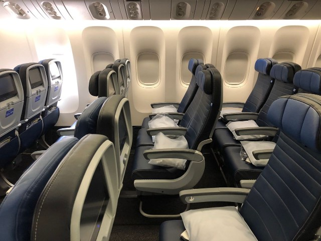 United Airlines Aircraft Fleet Boeing 777 300ER Standard Economy Class Cabin Seats Row Photos