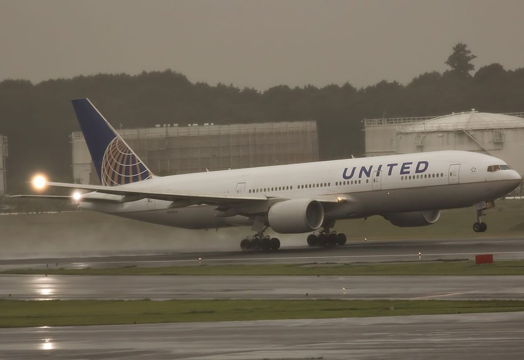 United Airlines Aircraft Fleet N212UA Boeing 777 222ER SN 30218293 on heavy rain at Narita International Airport IATA NRT ICAO RJAA