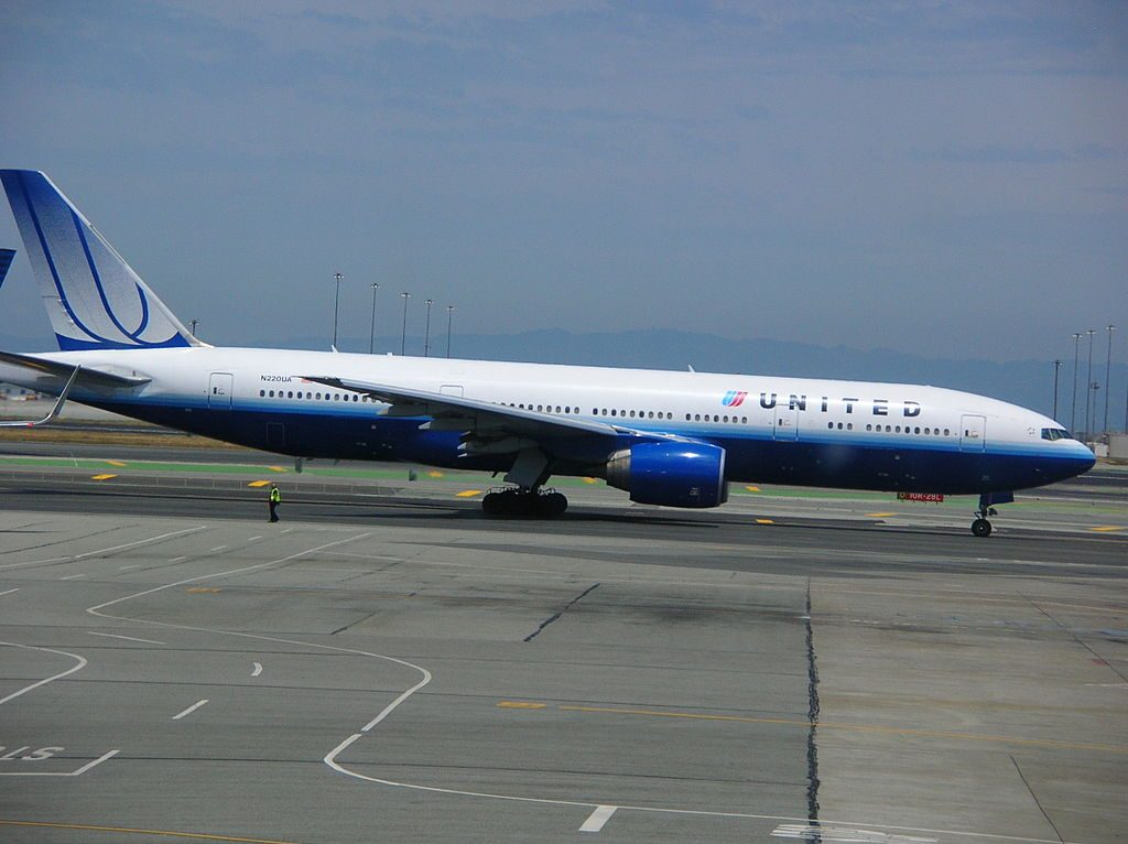 United Airlines Boeing 777 222ER tail number N220UA taxiing at San Francisco International Airport SFO