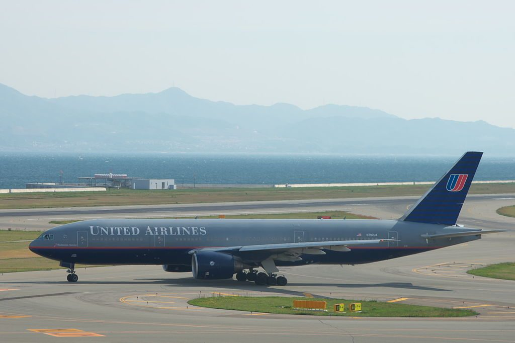 United Airlines Fleet B777 222ER N792UA flight UA886 for San Francisco is taxing to runway 24 end of Kansai international airport KIXRJBB