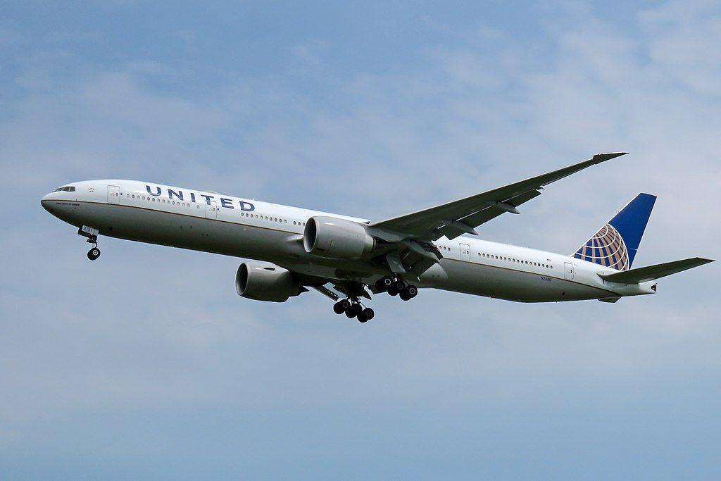 United Airlines Fleet N2331U Boeing 777 322ER cnserial number 626421453 long haul wide body aircraft short final at Beijing Capital International Airport IATA PEK ICAO ZBAA