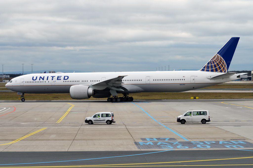 United Airlines Fleet N2639U Boeing 777 322ER long haul wide body aircraft at runway Heathrow Airport IATA LHR ICAO EGLL