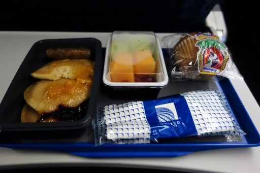 United Airlines Fleet Widebody Aircraft Boeing 777 200 Economy Class Cabin Inflight Amenities second meal service pancakes
