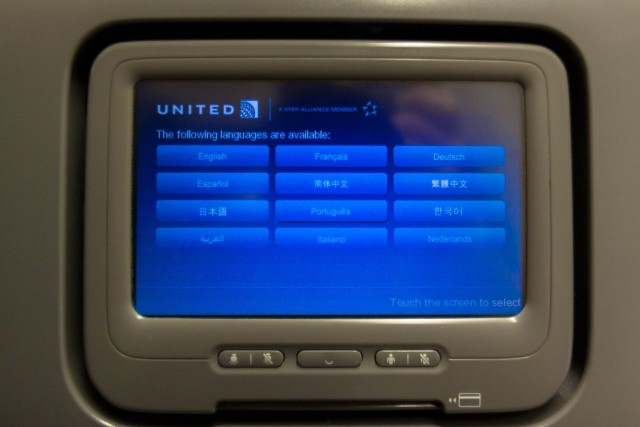 United Airlines Fleet Widebody Aircraft Boeing 777 200 Economy Class cabin long haul flight IFE system in UAs blue