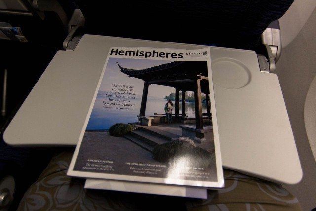 United Airlines Fleet Widebody Aircraft Boeing 777 200 Economy Class cabin long haul flight seatback literature Hemispheres magazine