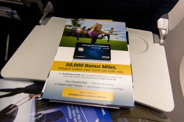 United Airlines Fleet Widebody Aircraft Boeing 777 200 Economy Class cabin long haul flight seatback literature pamphlets for United membership