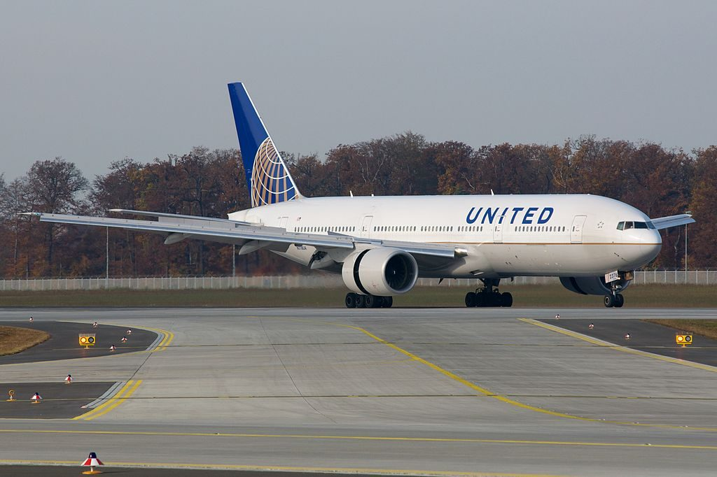 United Airlines Widebody Aircraft Boeing 777 200 N778UA Rolling out with reverse thrust engine at Frankfurt Airport IATA FRA ICAO EDDF Germany