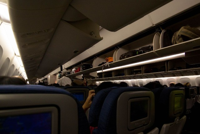 United Airlines Widebody Aircraft Boeing 777 200 regular economy class cabin full passenger photos