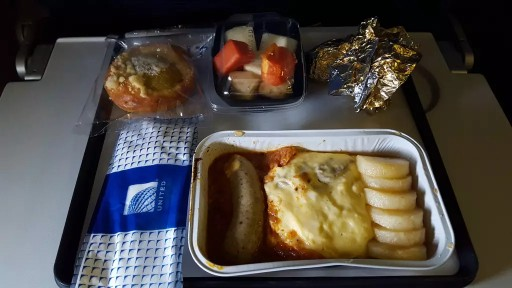 United Airlines Widebody Aircraft Boeing 777 200ER Economy Class Cabin Breakfast Menu scrambled eggs and pastry
