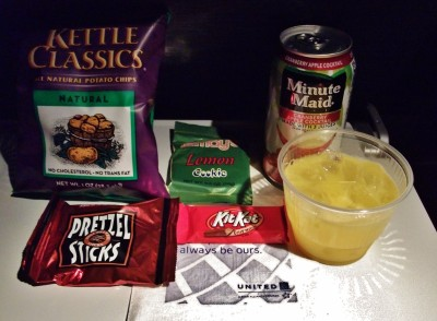 United Airlines Widebody Aircraft Boeing 777 200ER Economy Class Cabin Inflight Amenities Snacks and Drinks Services bag of chips kit kat lemon cookie and pretzel stick