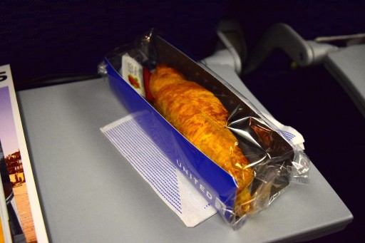 United Airlines Widebody Aircraft Fleet Boeing 767 400ER Standard Economy Class Cabin Inflight Amenities pre arrival breakfast service croissant rubbery and strawberry jam inside the wrapper