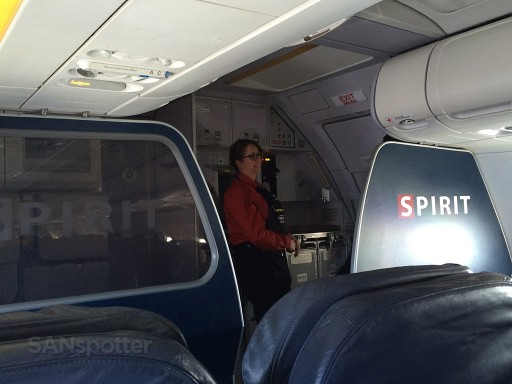 Airbus A319 100 Spirit Airlines Premium Eco Big Front Seat Cabin View with smiling FA @SANspotter