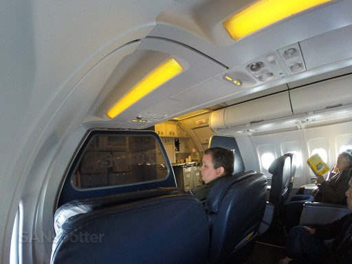 Airbus A319 100 Spirit Airlines Premium Eco Big Front Seat Wide angle shot of the forward cabin mid flight @SANspotter