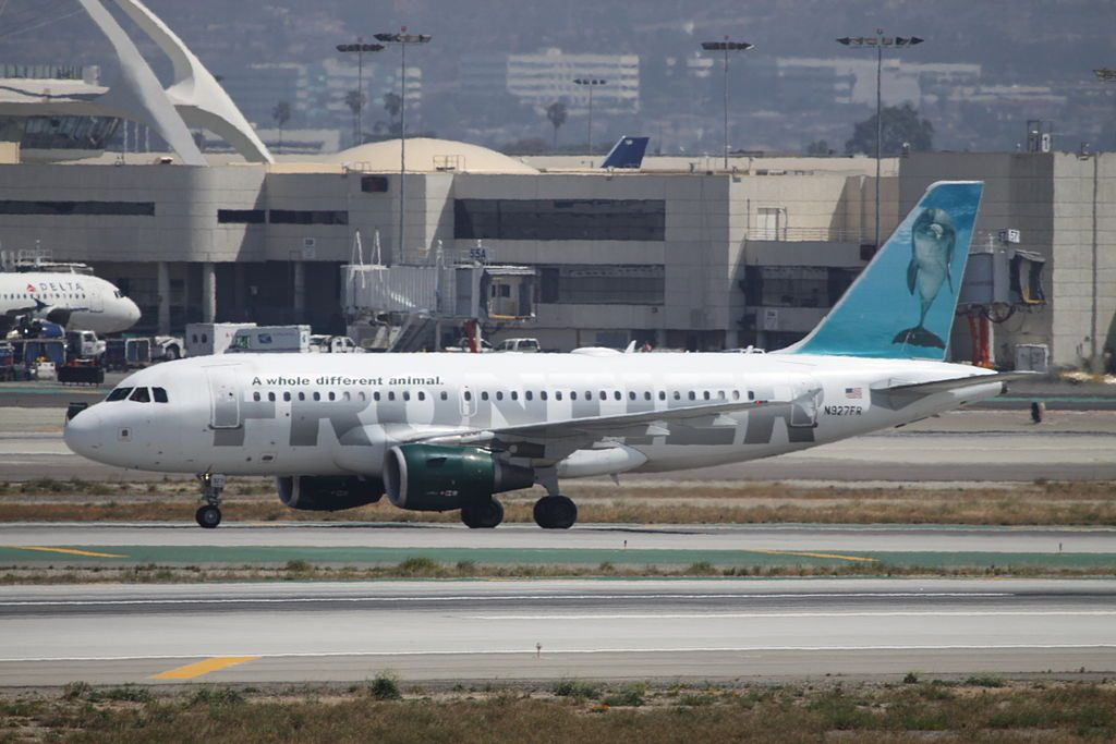 Airbus A319 111 Frontier Airlines Flip the Bottlenose Dolphin N927FR taxiing at LAX Airport
