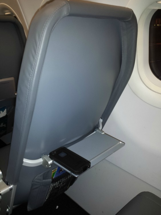 Airbus A320 200 Frontier Airlines mini tray table of backseat