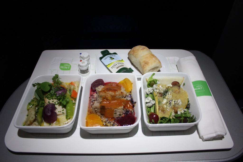 Airbus A321 200 JetBlue Mint Suite Business Class Cabin main courses Asian pear salad chicken dumplings and the bison meatloaf