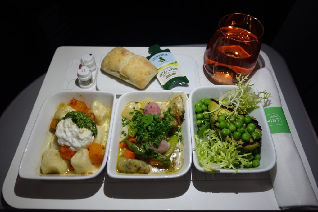 Airbus A321 200 JetBlue Mint Suite Business Class Cabin main courses ricotta gnudi and grilled avocado salad