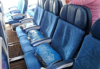 Airbus-A330-200-Hawaiian-Airlines-Economy-Class-Cabin-2-4-2-seats-configuration-with-plastic-wrapped-blanket-and-pillow